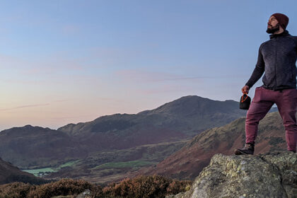 Man looking over mountain lake district