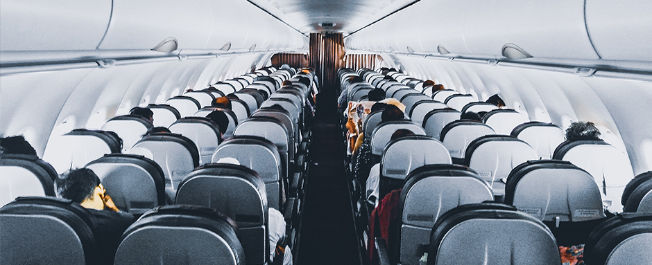 Walking down the aisle of an airplane