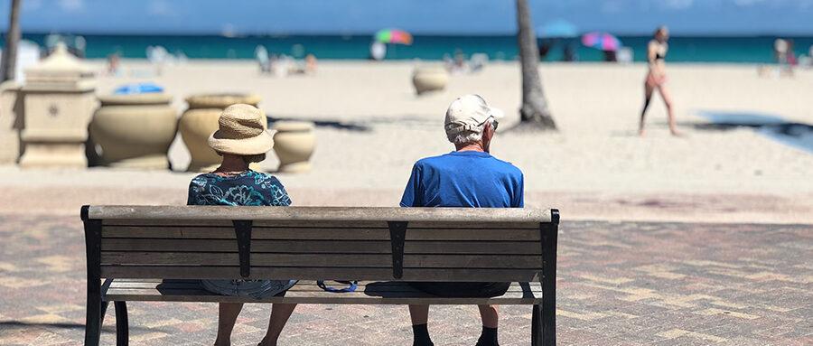 Elderly couple on a park bench