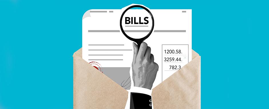 Hands magnifying bills