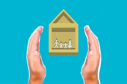 Hands insuring a home