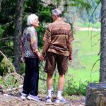 Retired couple walking through woods