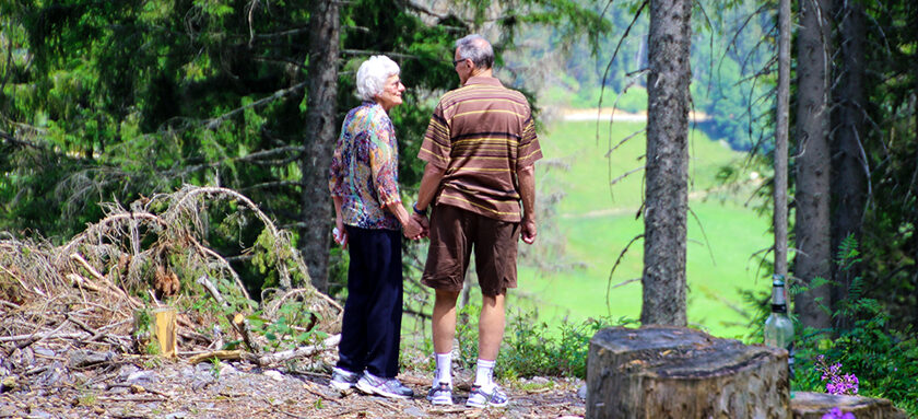 Retired couple walking through woods