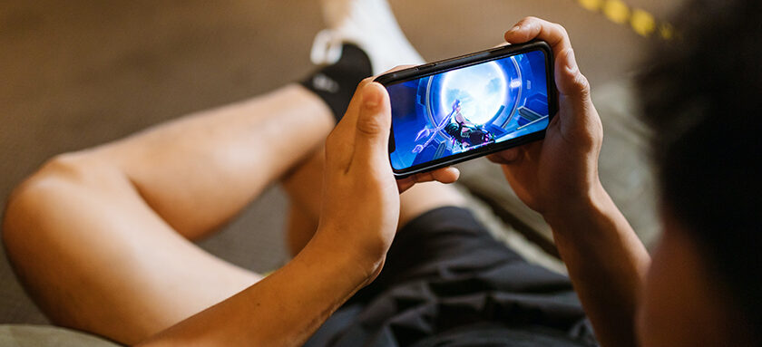 Teen Playing On Mobile Phone