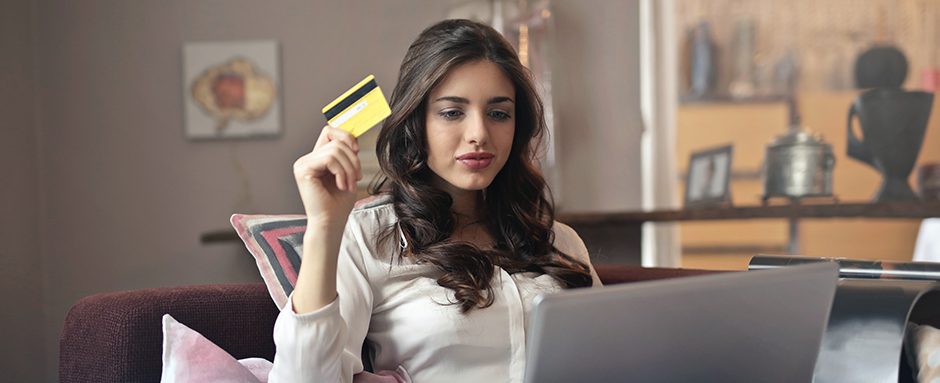 Woman spending with a credit card
