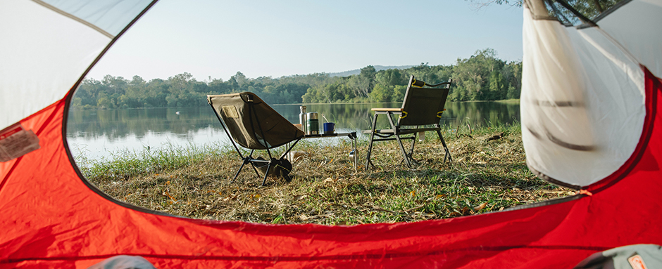 Two camping chairs on lake
