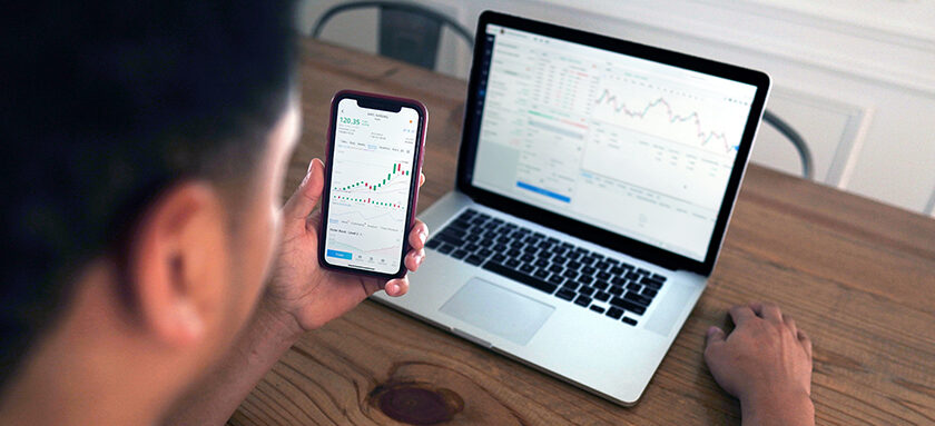 Man analysing stock charts